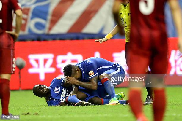 This photo taken on July 17 2016 shows Demba Ba of Shanghai Shenhua reacting after breaking his left leg during the 17th round football match of the...