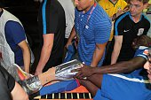 This photo taken on July 17 2016 shows Demba Ba of Shanghai Shenhua being stretchered out after breaking his left leg during the 17th round football...