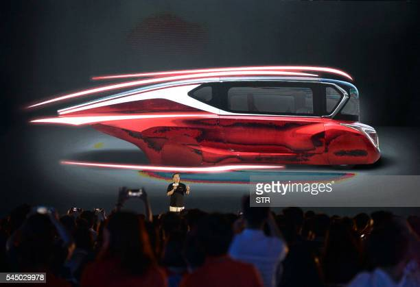 This photo taken on July 2 2016 shows a launch event of Hanergy's solarpowered cars in Beijing Thinfilm power giant Hanergy Holding Group Ltd...