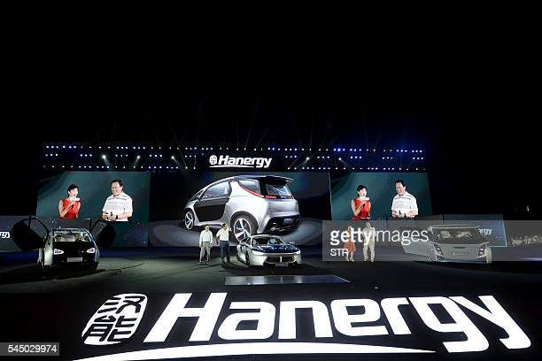 This photo taken on July 2 2016 shows Hanergy's solarpowered cars on display during a launch event in Beijing Thinfilm power giant Hanergy Holding...