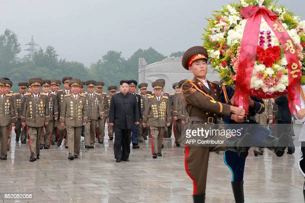 TOPSHOT This photo taken on July 27 2017 and released on July 28 2017 by North Korea's official Korean Central News Agency shows North Korean leader...