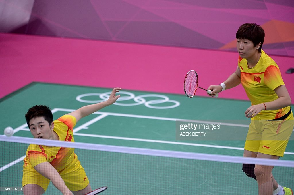 This photo taken on July 31 2012 shows Yu Yang and her teammate Wang Xiaoli during their women's double badminton match against Kim HaNa and Jung...