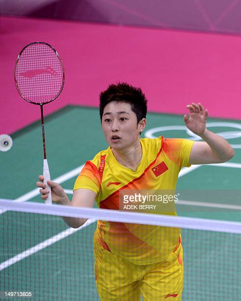 This photo taken on July 31 2012 shows Yu Yang playing a shot with her partner Wang Xiaoli during their women's double badminton match against Kim...