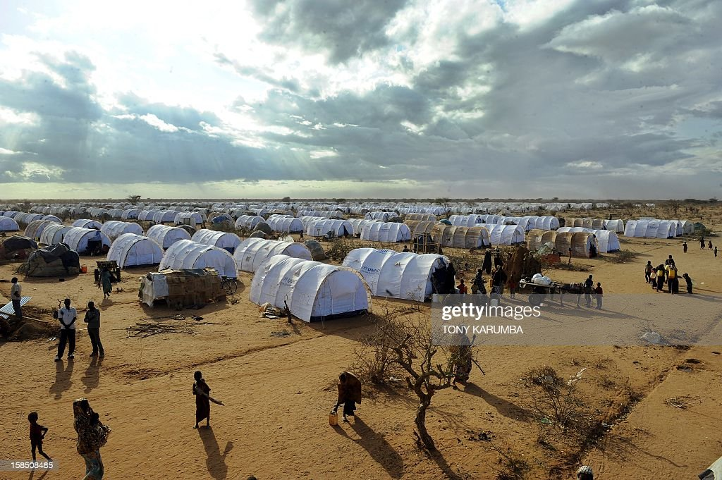 This photo taken on July 31 shows Somali refugees walking in the new Ifoextension at the Dadaab refugee camp in Kenya the largest refugee camp in the...