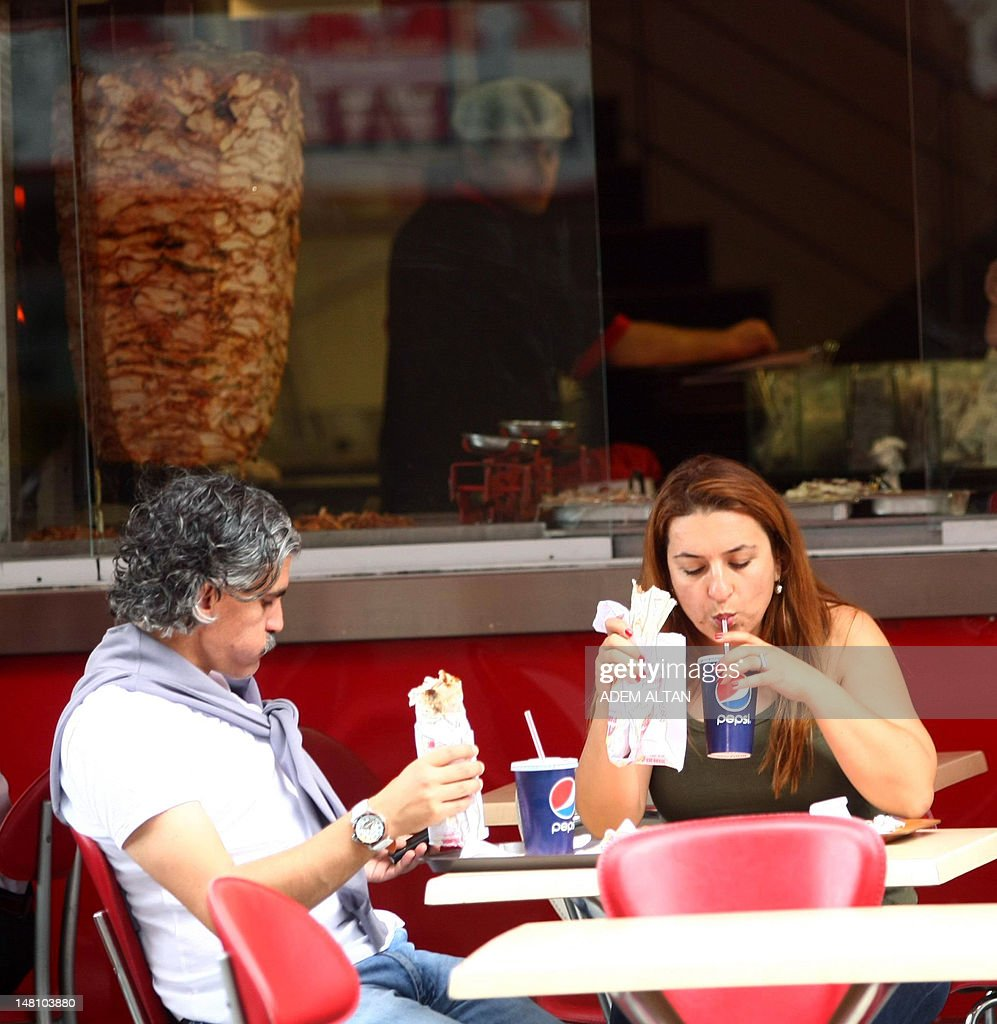This photo taken on July 4, 2012, in Ankara shows people eating at a local kebab reastaurant. In Turkey 35% of the population has accumulated excess body fat to the extent that it may have an adverse effect on health, leading to reduced life expectancy and/or increased health problems. The Turkish health ministry has launched a campaign calling on Turks to be more active.