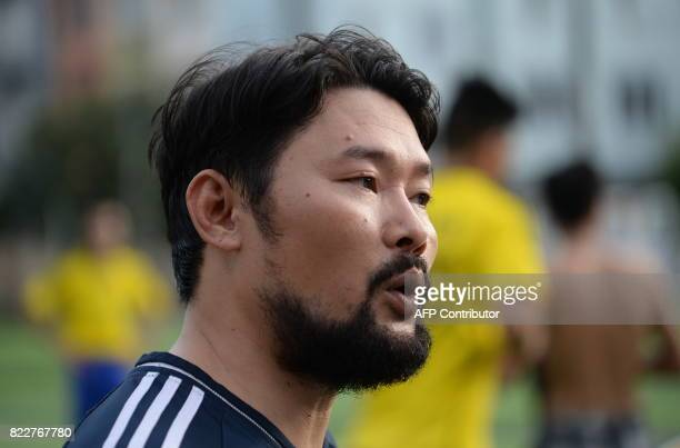 This photo taken on July 9 2017 shows activist Nguyen Chi Tuyen a founding member of the NoU FC squad speaking to AFP prior to their weekly football...