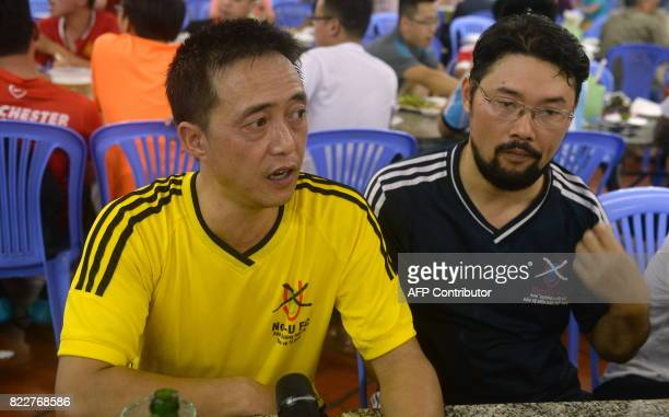 This photo taken on July 9 2017 shows activists Cuong Phap and Nguyen Chi Tuyen members of the NoU FC squad speaks to AFP at a party after playing in...