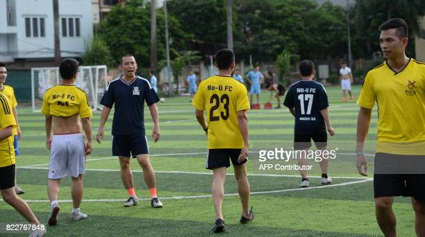 This photo taken on July 9 2017 shows members of the NoU FC squad playing in their weekly football match at a local pitch in Hanoi The team of...