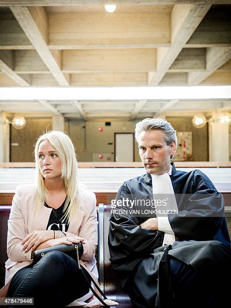 This photo taken on June 11 2015 shows a woman identified as 'Chantal' and her lawyer Thomas van Vugt sitting in a courthouse in Amsterdam during a...