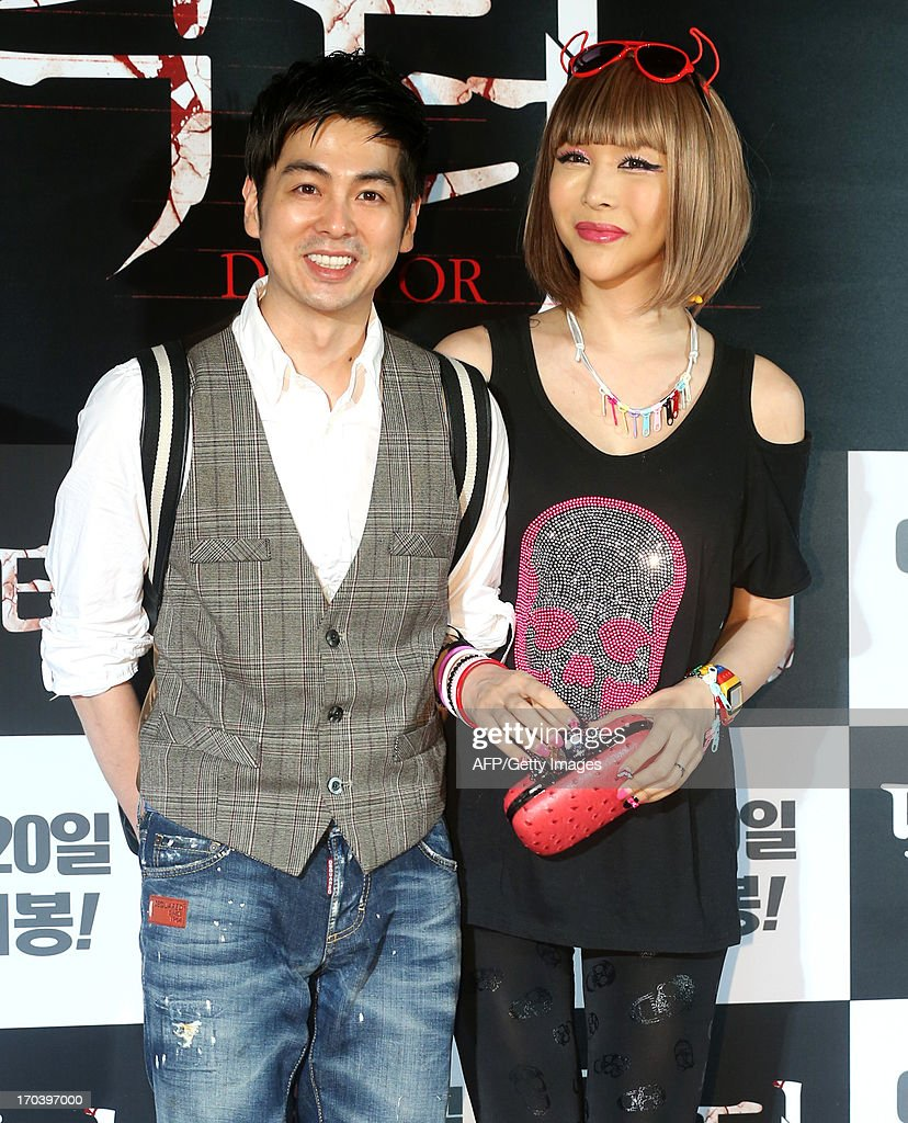 This photo taken on June 12 2013 shows South Korean singer Micky Jung and South Korean actress Harisu attending the 'Doctor' film premiere in Seoul...