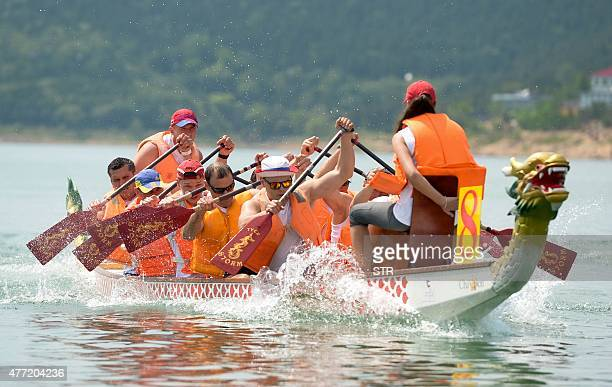 This photo taken on June 14 shows competitors taking part in a dragon boat race in the suburbs of Beijing The dragon boat festival also called...