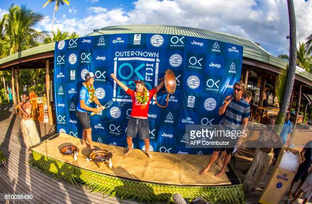 This photo taken on June 15 2017 shows winner Matt Wilkinson of Australia celebrating his victory in the OuterKnown Fiji Pro surfing competition at...