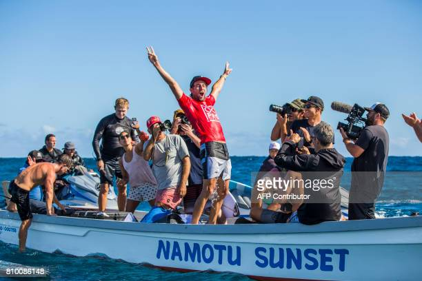 This photo taken on June 15 2017 shows winner Matt Wilkinson of Australia celebrating after the finals of the OuterKnown Fiji Pro surfing competition...