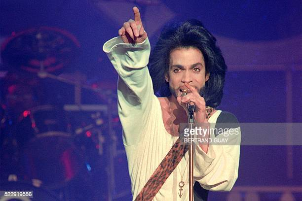 This photo taken on June 16 1990 shows musician Prince performing on stage during his concert at the Parc des Princes stadium in Paris Pop icon...