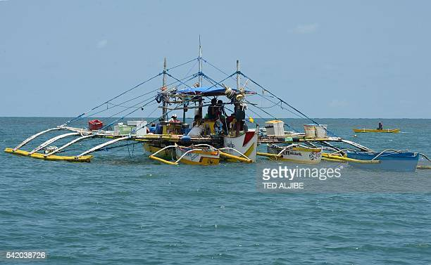 This photo taken on June 16 2016 shows a fishing vessel anchored at the mouth of the South China Sea off the town of Infanta in Pangasinan province...