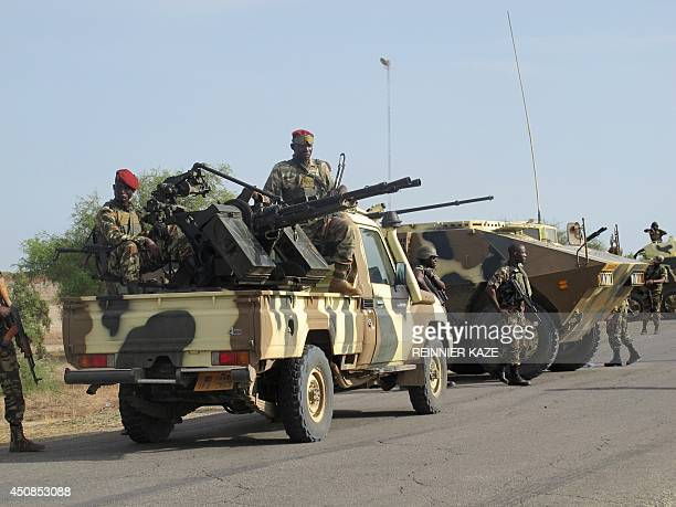 This photo taken on June 17 2014 in Dabanga northern Cameroon shows a convoy of Cameroon's soldiers as part of a reinforcement of its military forces...