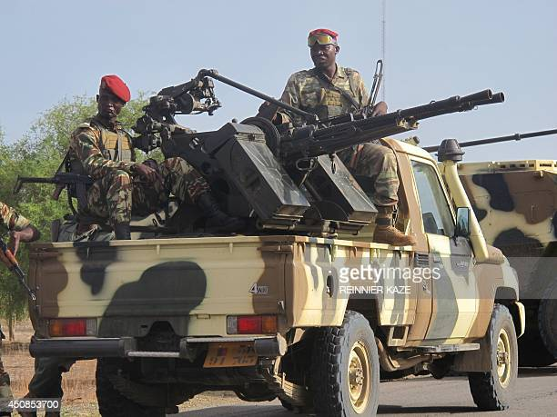 This photo taken on June 17 2014 in Dabanga northern Cameroon shows a convoy of Cameroon's army soldiers as part of a reinforcement of its military...