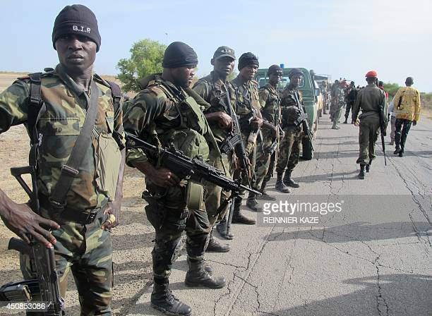 This photo taken on June 17 2014 in Dabanga northern Cameroon shows Cameroon's army soldiers deploying as part of a reinforcement of its military...