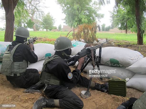 This photo taken on June 17 2014 in the border town of Amchide northern Cameroon shows police forces of the multipurpose intervention brigade holding...