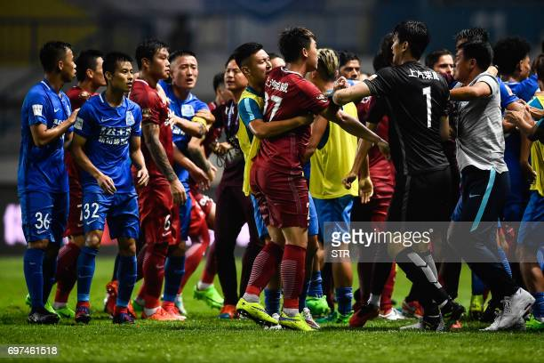 This photo taken on June 18 2017 shows a brawl between Shanghai SIPG players and Guangzhou RF players during their Chinese Super League football...