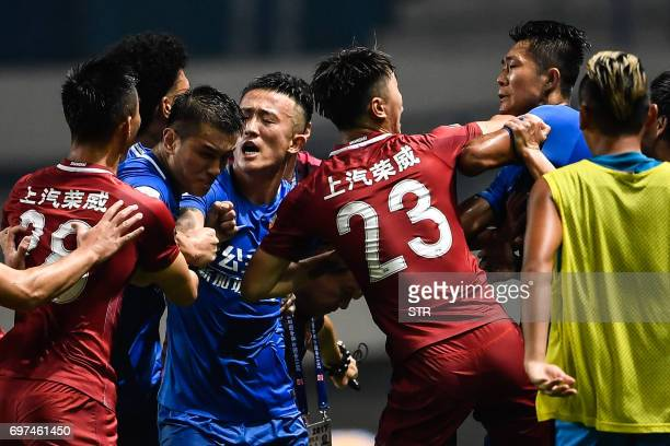 This photo taken on June 18 2017 shows a brawl erupting between Shanghai SIPG players and Guangzhou RF players during their Chinese Super League...