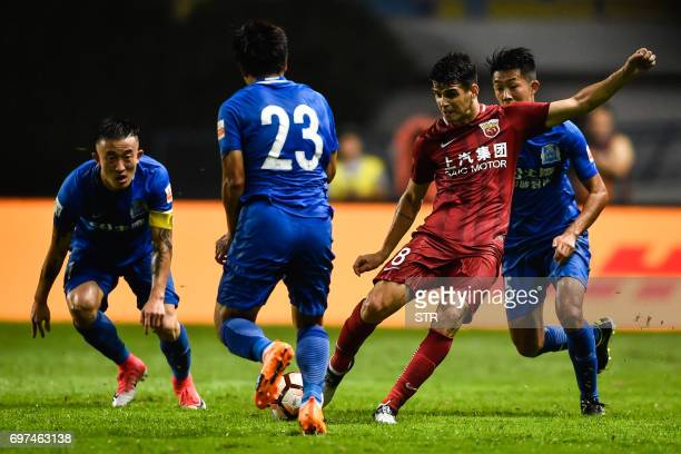 This photo taken on June 18 2017 shows Shanghai SIPG's Oscar kicking the ball at a Guangzhou RF player in an incident which lead to a brawl during...