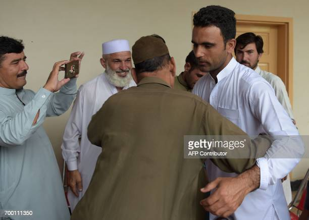This photo taken on June 21 2017 shows Pakistani cricketer Fakhar Zaman meeting with cricket fans at his guesthouse in his home village of Katlang in...