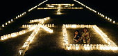 This photo taken on June 22 2016 shows candles displaying the Chinese characters for 'peace' in Okinawa on the eve of a ceremony marking the 71st...