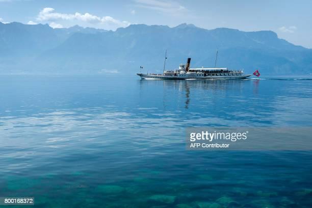 This photo taken on June 22 2017 shows the paddle steamboat 'Vevey' sailing on Lake Geneva on June 22 2017 off Saint Saphorin western Switzerland /...
