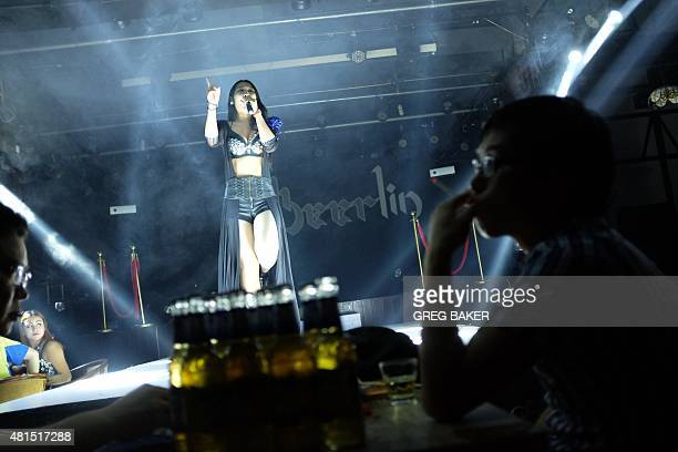 STORY 'CHINANKOREARUSSIAECONOMYDIPLOMACY' FOCUS This photo taken on June 24 2015 shows a performer in a bar in Hunchun which shares a border with...