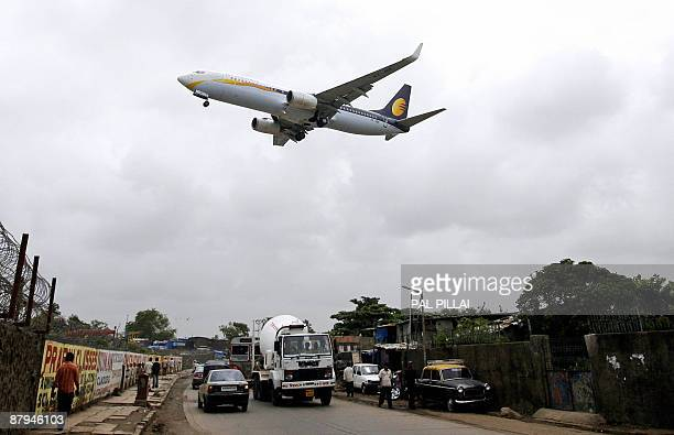 MACRAE This photo taken on June 24 shows a Jet Airways aircraft preparing to land at the Mumbai Airport in Mumbai India's airlines are caught in a...