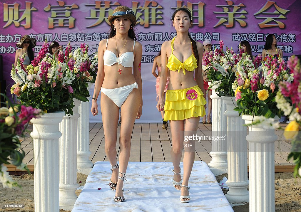 This photo taken on June 25 2011 shows a group of Chinese women parading in their bikinis during a matchmaking event for wealthy men with assets over...