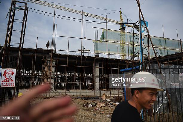 STORY 'CHINANKOREARUSSIAECONOMYDIPLOMACY' FOCUS This photo taken on June 25 2015 shows workers at a construction site in the Hunchun SinoRussian...