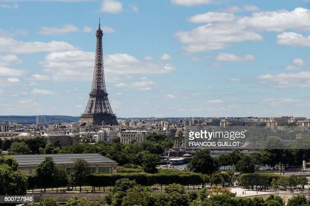 This photo taken on June 25 2017 from the rooftop of the Hotel Meurice in Paris shows the Eiffel Tower and the Tuileries Garden / AFP PHOTO /...