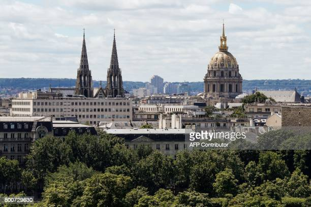 This photo taken on June 25 2017 from the rooftop of the Hotel Meurice in Paris shows the spires of the Basilica of Saint Clotilde and the golden...