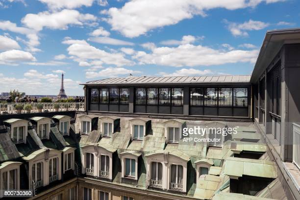 This photo taken on June 25 2017 from the rooftop of the Hotel Meurice in Paris shows the Eiffel Tower / AFP PHOTO / FRANCOIS GUILLOT
