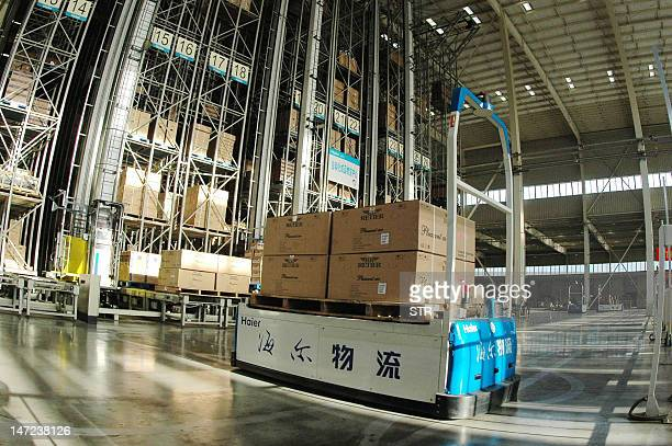 This photo taken on June 26 2012 shows an automated storage unit at the Haier factory in Qingdao northeast China's Shandong province Haier the...