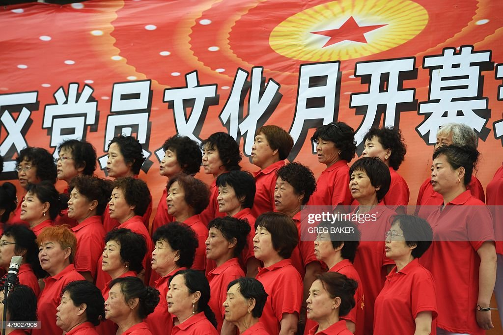 This photo taken on June 26 2015 shows members of a choir singing at a ceremony marking the 94th anniversary of the Chinese Communist Party in...