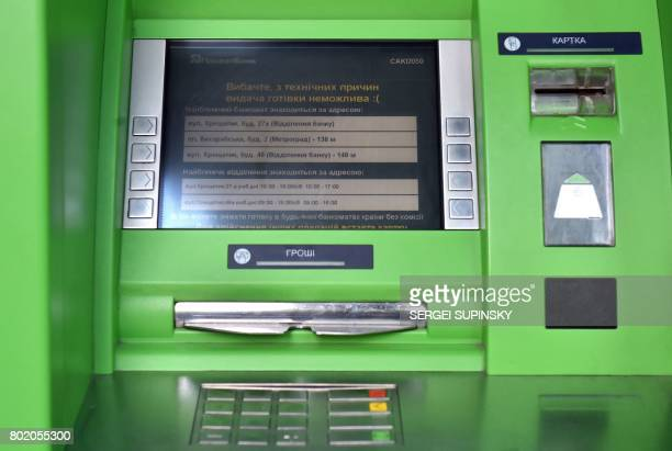 This photo taken on June 27 2017 in Kiev shows a view of banking machine of Privat Bank reading 'Sorry for technical reasons cash is not possible'...