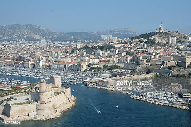 This photo taken on June 30 2015 shows an aerial view of the Old Port of the city of Marseille AFP PHOTO / POOL / BORIS HORVAT