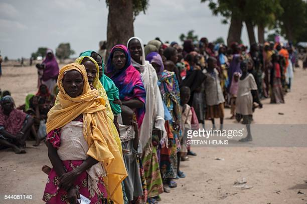 TOPSHOT This photo taken on June 30 2016 shows Women and children waiting in a queue to visit one of the Unicef nutrition clinics in the Muna...