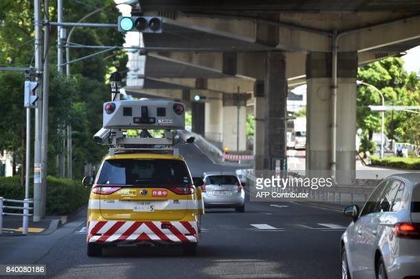 This photo taken on June 5 2017 shows an 'Infra Doctor' vehicle used by the Tokyo highway inspection system driving under a section of highway in...