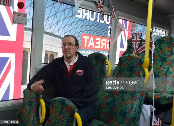 This photo taken on June 6 2017 shows Joel Watson first secretary at the British High Commission sitting on a bus in Auckland set up as a mobile...