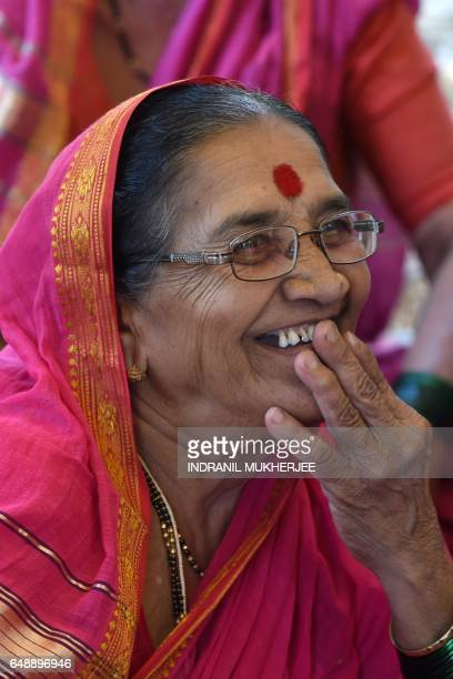This photo taken on March 1 2017 shows Indian grandmother Nirmala Kedar reading the Marathi alphabets in a class at Aajibaichi Shala or 'school for...