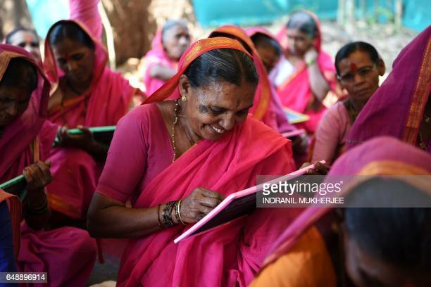 This photo taken on March 1 2017 shows Indian grandmother Savita Deshmukh during class at the Aajibaichi Shala or 'school for grannies' in the local...