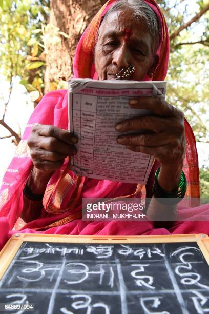 This photo taken on March 1 2017 shows Indian grandmother Sulochona Kedar attending a class at Aajjibaichi Shala or 'school for grannies' in the...