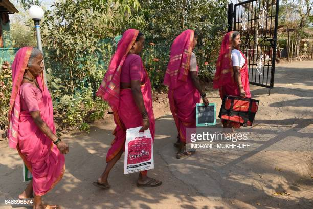 This photo taken on March 1 2017 shows Indian women leaving a class from Aajibaichi Shala or 'school for grannies' in the local Marathi language in...