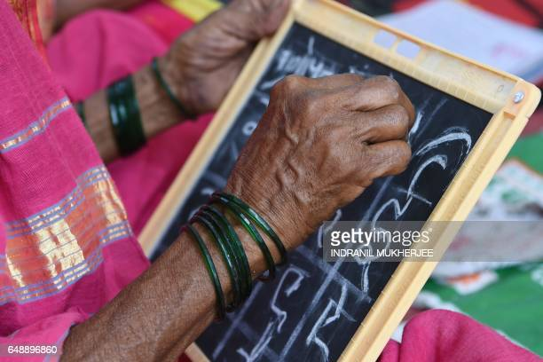 This photo taken on March 1 2017 shows Sulochona Kedar working in a class for elderly women mostly aged between 60 and 90 at Aajibaichi Shala or...