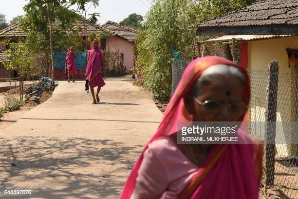 This photo taken on March 1 2017 shows women arriving for class at Aajibaichi Shala or 'school for grannies' in the local Marathi language in...