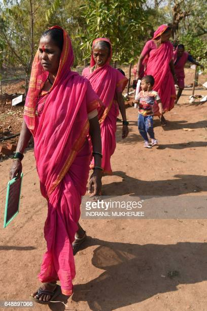 This photo taken on March 1 2017 shows women walking home from Aajibaichi Shala or 'school for grannies' in the local Marathi language in Phangane...